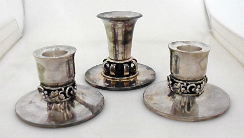 a pair of georg jensen silver candlesticks and another. Black Bedroom Furniture Sets. Home Design Ideas